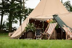 Relaxed tipi wedding. Deck Chair Hire from Nerrisa Eve. Festoon Walkway. Plan your Sami Tipi Wedding at Pipewell Hall, Northampton - Image by Sarah Vivienne Photography