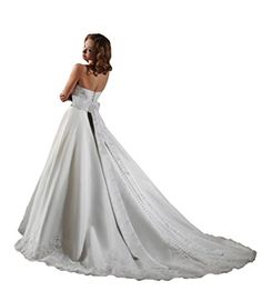 Wedding Dress by Bonny Bridal 125. Strapless sweetheart beaded lace appliqued neckline. Wide band at the empire waist with a self tie back. Long full ball gown skirt with beaded applique hemlines but...