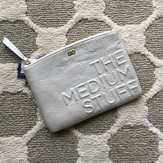 💮 PM Editor Pick 💮 Cole Haan Leather Pouch fully lined in a Silver Metal color labeled as Oyster. I will update with measurements shortly. Cole Haan Bags