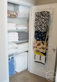 in winterime - fleece blankets on towel rack (Duo Ventures: Organizing: The Linen Closet)