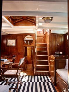 Mabrouka's saloon features mahogany paneling and built-ins.