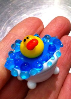 Flamework glass duck in bathtub.  A studio demo by Heather Sellers. There he is !! so cute :)