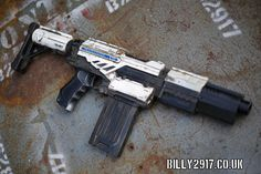 nerf call of duty peacemaker well sort of its black & white anyway! nerf call of duty peacemaker Cosplay Weapons, Weapons Guns, Nerf Gun Attachments, Modified Nerf Guns, Cool Nerf Guns, Nerf Darts, Nerf Mod, Concept Weapons, Air Rifle