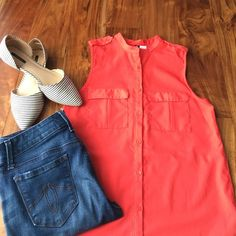 H&M buttoned down top Buttons going all the way down shirt with two pockets at chest. Buttons at shoulder detailing as well. Color is like an reddish orange. In good condition some mild piling as seen in last pic. Fabric is 100% polyester H&M Tops Button Down Shirts