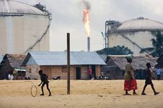 In the Niger Delta, oil turns the rivers rainbow. Surrounding communities are engulfed in the emissions from constant natural-gas flaming. Generations that used to survive on fishing are now jobless and wandering — some have joined local militant guerrilla groups in an attempt to defend their land against the pillage of the oil industry.