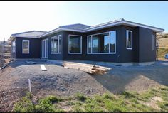 Resene Fuscous Grey by Karen Walker on exterior cladding - New build Wellington - Dark exterior light trims  - Charcoal house  -  Resene rockcoat   - Estilo  - @resene @habitatbyresene