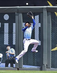 Kansas City Royals right fielder Jarrod Dyson leaps to rob Baltimore Orioles' Adam Jones of a hit in the fourth inning during Sunday's baseball game on April 24, 2016 at Kauffman Stadium in Kansas City, Mo.