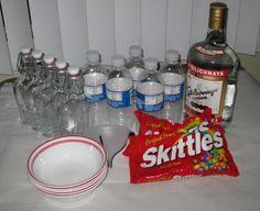 Water bottles, glass bottles, bowls, a big Skittles bag and a large bottle of vodka