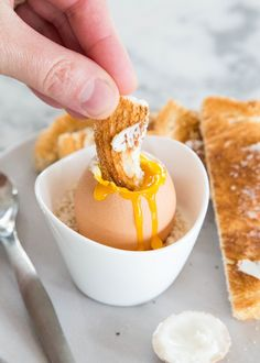 The perfect soft-boiled egg should have firm, custard-like whites and a warm runny yolk. Serve with a spoon for scooping and plenty of buttered toast.