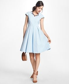"""Fully lined, our pleated V-neck dress is made from stretch cotton and has cap sleeves and a fit-and-flare silhouette. This dress features intricate novelty seaming details and zigzag stitching around the top. Zipper closure down the center back.<br><br>37"""" center back length; dry-clean only; woven in Italy; imported."""