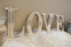 large LOVE letters decorated with lace, twine, and pearls to add to rustic or vintage décor for a wedding - thereddirtbride.com - see more of this wedding here Initial Decor, Vintage Décor, Rustic Chic, Love Letters, Twine, Initials, Pearls, Frame, Wedding