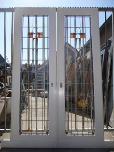 Kamer en suite deuren 100.40.102217 - Leen - Oude bouwmaterialen, 5000 oude deuren, paneeldeuren, kamer en suite schuifdeuren, voordeuren, glas-in-lood deuren, portaaldeuren, ramen, marmeren schouwen, wasbakjes, fonteintjes, balusters, antiek, curiosa