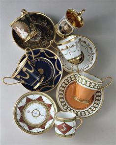 Sevres porcelain cups and saucers for coffee and chocolate in the neoclassical style of late 18th and early 19th century. One of them has the portrait of Empress Josephine by Ms. Jacquot; and another the portrait of Bonaparte by Gerard after Isabey. National Ceramics Museum in Sèvres.