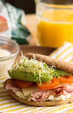 Egg White, Ham and Avocado Breakfast Sandwich: Savor this simple summertime breakfast sandwich with avocado, egg whites, ham, cheese and tomato on a Thomas' 100% Whole Wheat Bagel Thins bagel. [Promotional Pin]