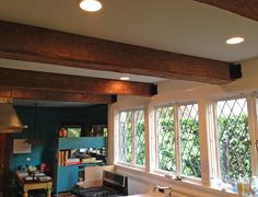 Some beautiful hand hewn beams in this Portland home http://www.craftmarkinc.com/reclaimed-timber-products/