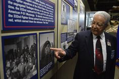Tuskegee Airman Lt. Col. (Ret.) George Hardy views the Tuskegee Airmen Exhibit in the WWII Gallery at the National Museum of the U.S. Air Force