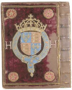 The cover of one of Henry VIII's books.  This is purple velvet and embroidered motifs.
