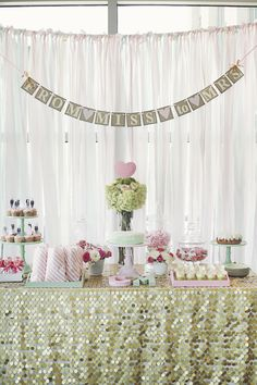 Mint Green and Pale Pink Bridal Shower Dessert Table   http://couldbeinteresting.com/a-mint-and-pink-bridal-shower/#