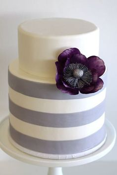 Luxury Purple Wedding Cakes--this would be lovely as part of a trio.  LOVE the dark purple flower.  Ideas for Laurie