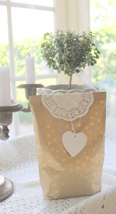 stamped paper bag + doily + tag