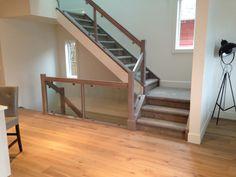 Pravada Engineered Hardwood (Haute Couleur, Brule) and Kraus Carpet (Midtown, Ghost Grey). Supplied and Installed by Floor Trendz