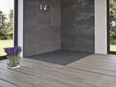 The Slate shower tray is modelled after a large piece of natural slate. As a result, the shower tray brings an authentic slate textured finish and therefore Shower Tray Ideas, Versatile Tile, Shower Tray Sizes, Slate Shower, French Country Bathroom, Shower Tray, Flooring, Luxury Shower, Slate