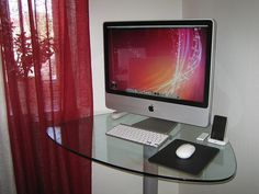This is a picture of a new model Apple desktop. This shows how far computers have come in the last 20 years; they have become slim and sleak and take up very little space. The price for the performance is equal and computers like this one is a common site in many American households. I think it is astonishing that so much can be done by a device as small as this.
