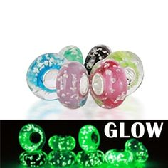 """$24.99 """"The lights will never go down on you when you?re sporting these Glow in the Dark Murano Glass Beads on your Pandora compatible designer inspired fashion jewelry bracelet! Each of the Six round glass beads are a different color: mint green, neon yellow, black, turquoise, rose pink, and violet, and is highlighted by flecks of glow in the dark speckled throughout the glass..."""