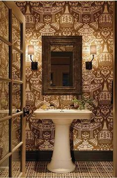 Oversize Asian ceramic jars and parasols are blown up and rendered almost like woodblock prints in this densely patterned cocoa and cream wallpaper.  Rather than fighting the paper, the geometric pattern of the tile floor supports it and dark baseboard frames them both.