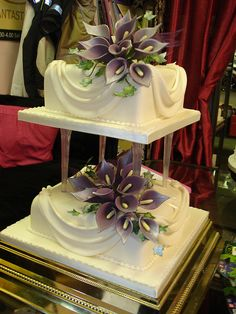 Traditional Drapes and Purple Lily Wedding Cake