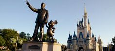 The Magic Kingdom, Walt Disney World Florida.  Shown is Cinderella's Castle and the wonderful statue of Walt and Mickey!