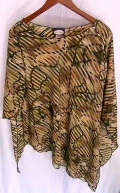 """This is a gently worn Zoey Beth design tan brown black green plus 1X casual carreer evening Womens Top. This top looks brand new. This is one of the coolest designs I have ever seen. There is a 3-D effect in the print design. The style says comfort. The look says fashion. The sleeves have a unique design as well. The top of the sleeve is shorter than the bottom by 10"""" making the sleeves 3/4 to full length, sort of. This is an eye catching unique piece of art."""