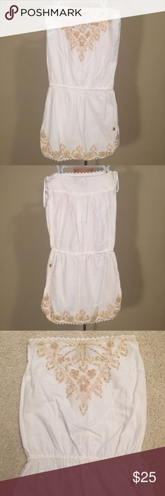 Cynthia Rowley White Beach Cover-Up Excellent condition, no defects, worn once. Cynthia Rowley strapless white beach cover-up, size small. Cream stitching with gold sequins along top and bottom of dress. Lace detail at bottom of dress below stitching. Elastic at top of dress in the back and also at the waistband for perfect fit. Small slits on both sides at bottom of cover-up. Lightweight, 100% cotton. Cynthia Rowley Swim Coverups