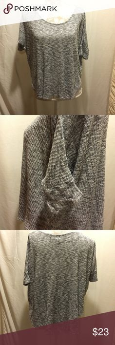 Gray short sleeve loose fit top Loose fit , in excellent condition material is 75% rayon 25% polyester . It is a little longer in the back Full Tilt Tops Blouses
