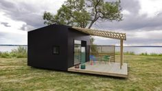 Me Like this Idea...  Mini House is a functional prefabricated modular home that comes delivered flat-packed and can be constructed on-site in just two days.