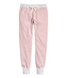 Pink/striped. Joggers in lightweight sweatshirt fabric with an elasticized drawstring waistband and ribbed hems. Soft, brushed inside.