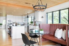 The breakfast area at DIY Network Blog Cabin 2016 creatively uses pieces from a classic boat to create a casual eating space with a distinctive look and sense of fun. >> http://www.diynetwork.com/blog-cabin/2016/breakfast-nook-pictures-from-diy-network-blog-cabin-2016-pictures?soc=pinterest