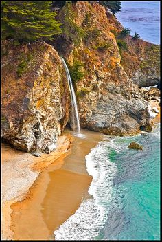 """McWay Falls is an 80-foot waterfall located in Julia Pfeiffer Burns State Park that flows year-round. This waterfall is one of only two in the region that are close enough to the ocean to be referred to as """"tidefalls"""", the other being Alamere Falls. Wikipedia. Roberto Portolese Travel & Tourism Photography"""