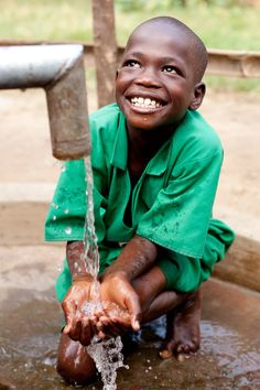 A charity: water well in Uganda. Water changes everything.