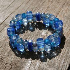 Nice bright and colourful elastic double-stranded bracelet, with lots of different glass and plastic beads.