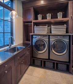 Focus: butcher block shelf above appliances to hold (multiple) large laundry baskets with cubby above.
