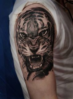 Suchen Sie nach coolen Ideen für ein Tiger Tattoo? Hier finden Sie 70 super effektvolle Bilder, von denen Sie sich Inspiration holen können!