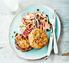 A plate with miso burgers with mint & pomegranate slaw