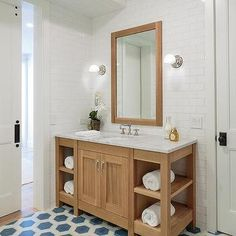 Honey Stained Washstand with Blue Hexagon Floor Tiles