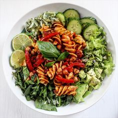 thebananagal:  shana-makins:  Tomato and chickpea pasta + greens =  Spinach leaves, lettuce, avocado, cucumber, sauerkraut, basil, lime, chia seeds and vinegar.  ❦