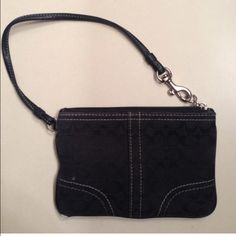Coach wristlet Black, little white spot on front. One corner has a little wear as shown in picture. Coach Bags Clutches & Wristlets