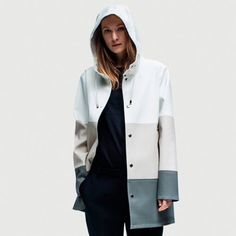 The Stockholm Color Block raincoat in White, Grey and Light Sand is handmade in rubberized cotton, unlined and with double welded seams. The finest craftsmanship is used to create this beautiful rainc