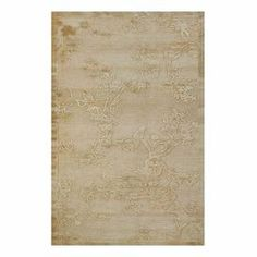 Faux silk rug with an ivory floral motif.   Product: RugConstruction Material: Faux silkColor: IvoryFeatures:  Power-loomedMade in Turkey Note: Please be aware that actual colors may vary from those shown on your screen. Accent rugs may also not show the entire pattern that the corresponding area rugs have.Cleaning and Care: Vacuum on hard floor setting. No beater bar. Professional cleaning recommended.