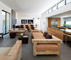 Terrific-Contemporary-Living-Room-Furniture-with-Wooden-Sofas-Combined-with-Stylish-Coffee-Table-Wooden-Bench-and-Small-Ottoman : Inspirational Interior and Exterior Home Design Ideas – TheMakaroni.com