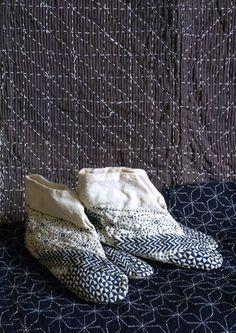 A pair of blue-on-white sashiko-stitched tabi. Indigo-dyed cotton yarn on white cotton. Japan.